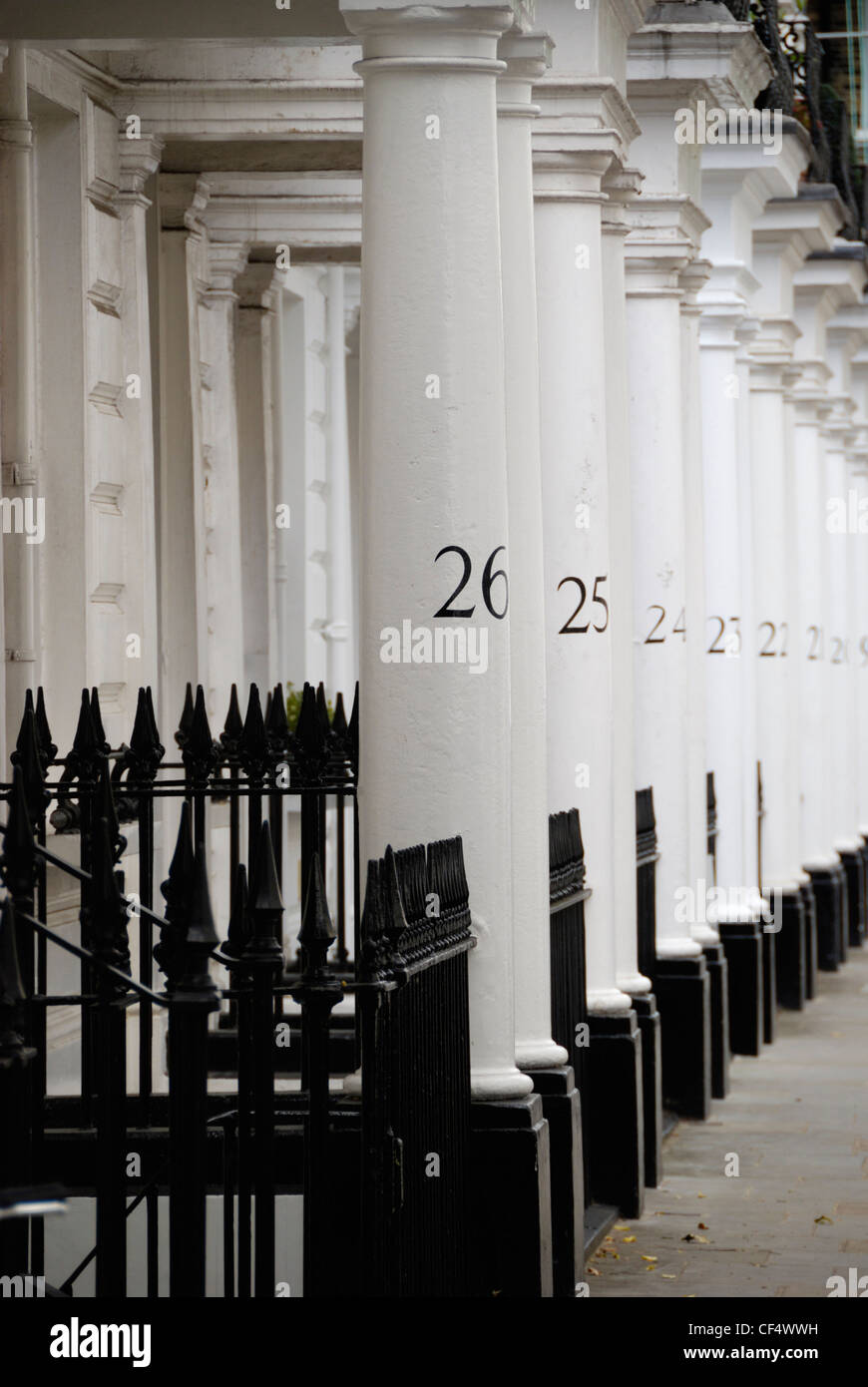 Numbered white stone columns in Neville Street SW7. - Stock Image