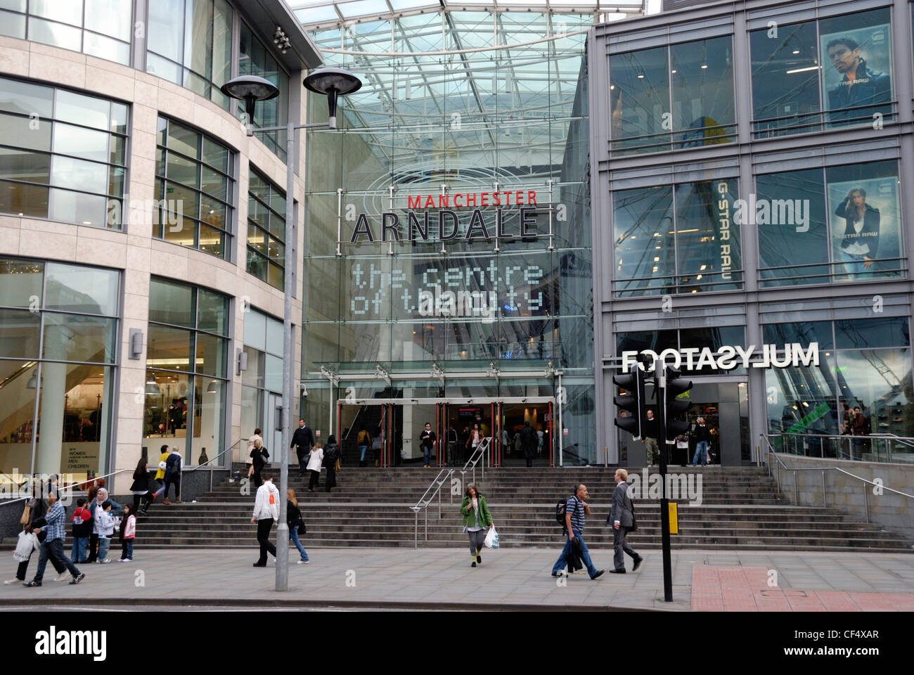 Shoppers outside the Manchester Arndale, the UK's largest inner-city shopping centre, located in the heart of - Stock Image