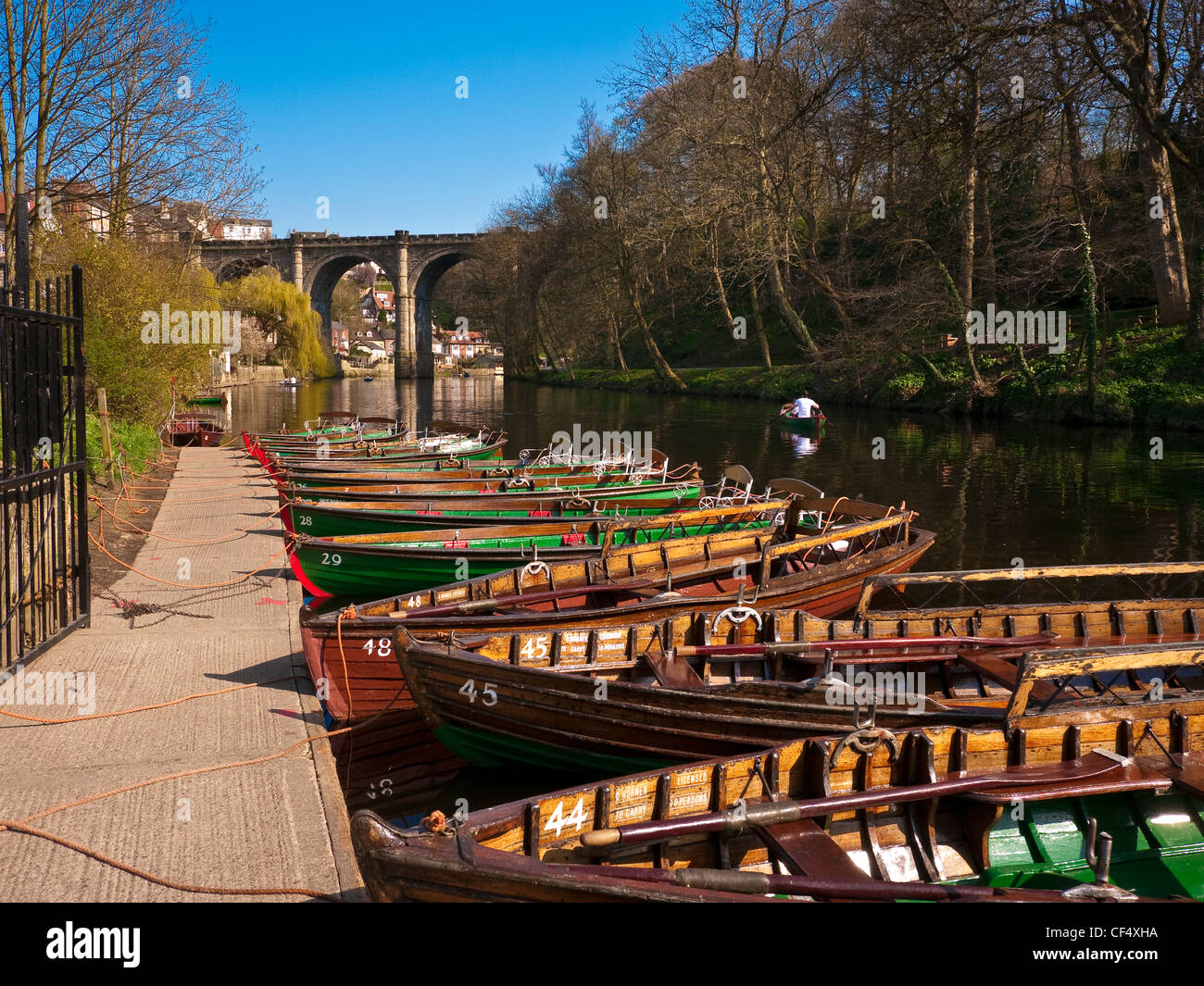 Rowing boats for hire on the River Nidd. The Knaresborough Viaduct, built in 1851 to carry Victorian rail traffic - Stock Image