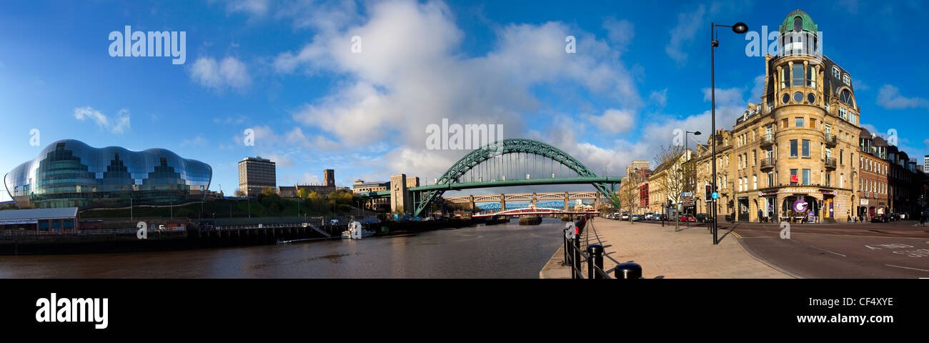 The Sage Gateshead and the Tyne Bridge spanning the River Tyne viewed from the Newcastle quayside. - Stock Image