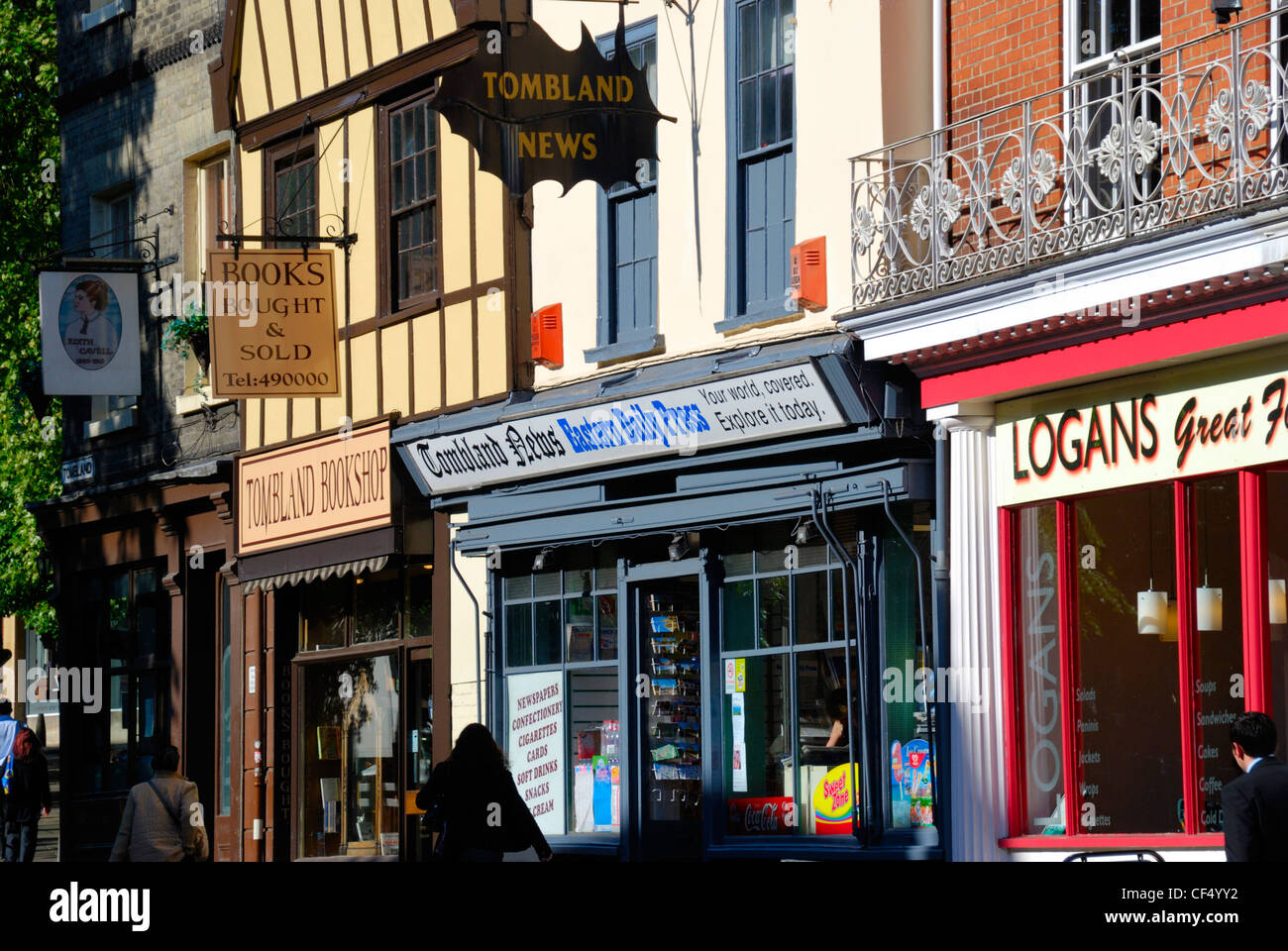 Shop fronts in the historic Tombland area, site of the original marketplace of Anglo-Saxon Norwich. - Stock Image