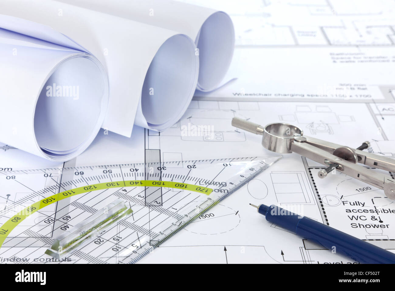 Architectural building plans blueprint stock photos architectural still life photo of architectural floor plans with drawing instruments malvernweather Gallery
