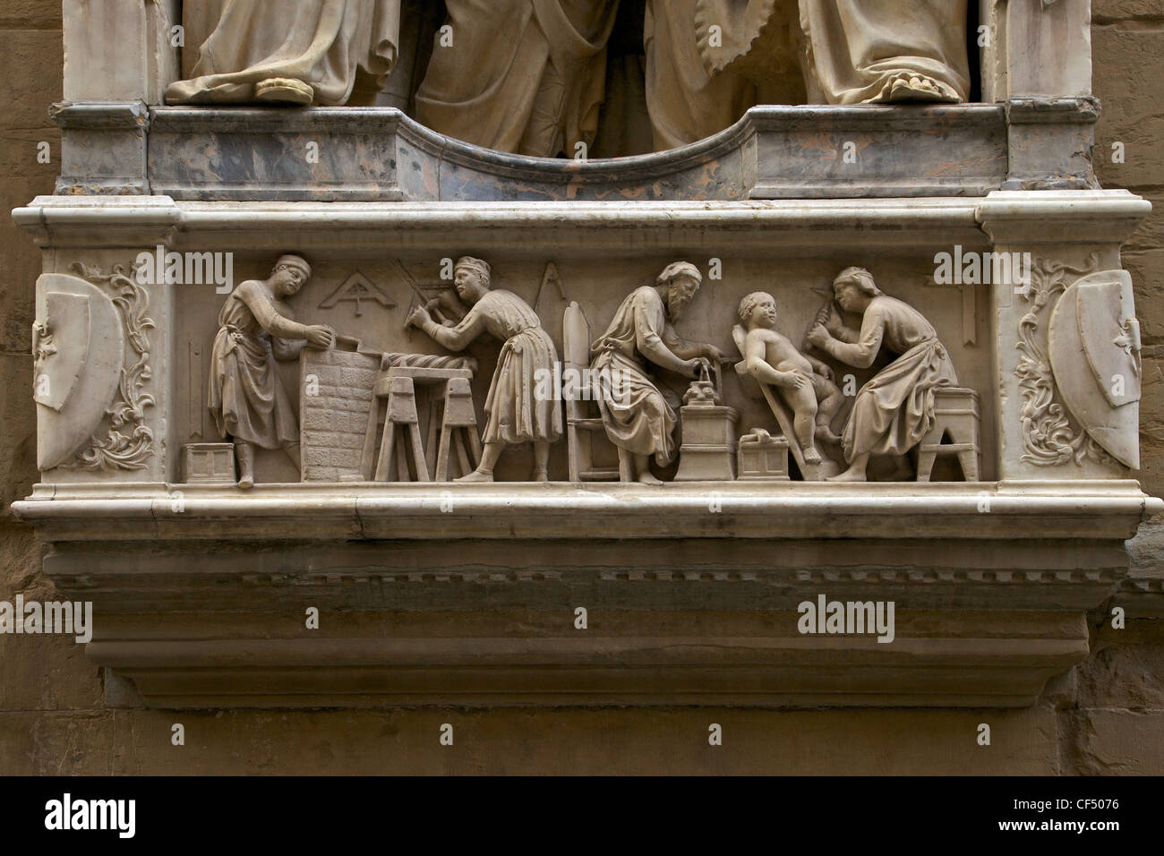 Carpenters and stonemasons at work, marble relief frieze, exterior of Orsanmichele, Florence, Tuscany, Italy, Europe - Stock Image