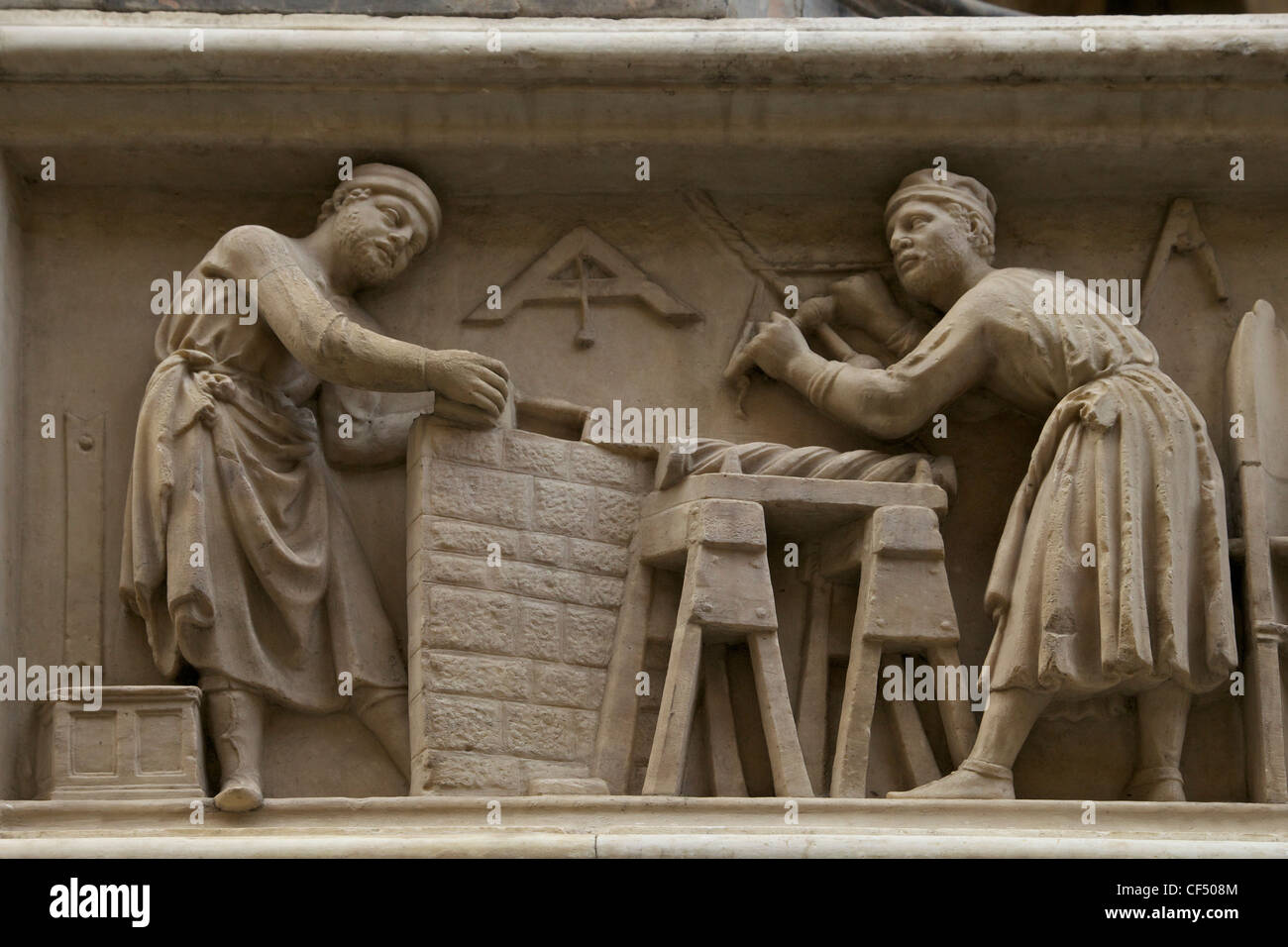 Carpenters at work, marble relief frieze, exterior of Orsanmichele, Florence, Tuscany, Italy, Europe - Stock Image