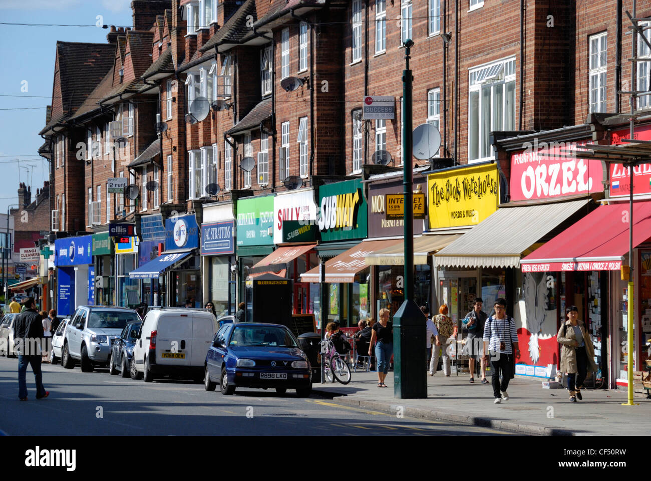 A variety of shopfronts on Golders Green Road. - Stock Image