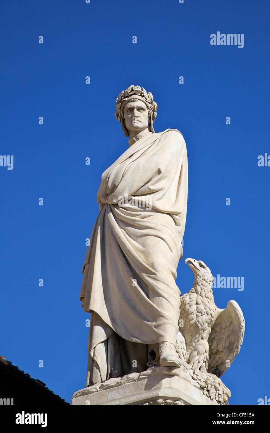 Statue of poet Dante Alighieri in front of Santa Croce church in Piazza Santa Croce, Florence, Tuscany, Italy, Europe - Stock Image
