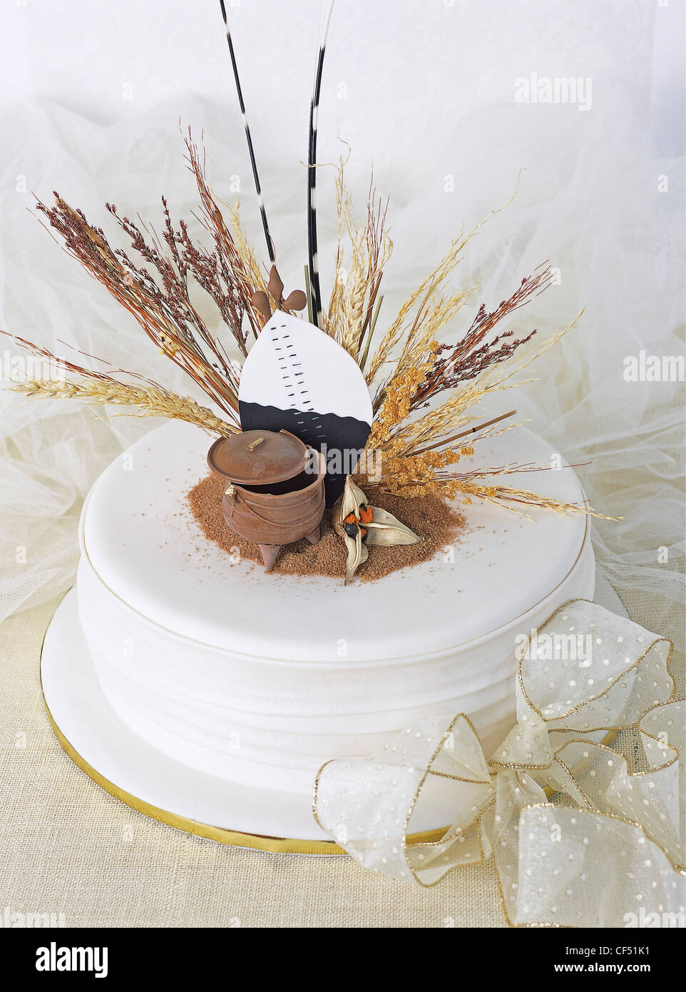 Fruit cake decorated with a chocolate three legged pot and a sugar ...