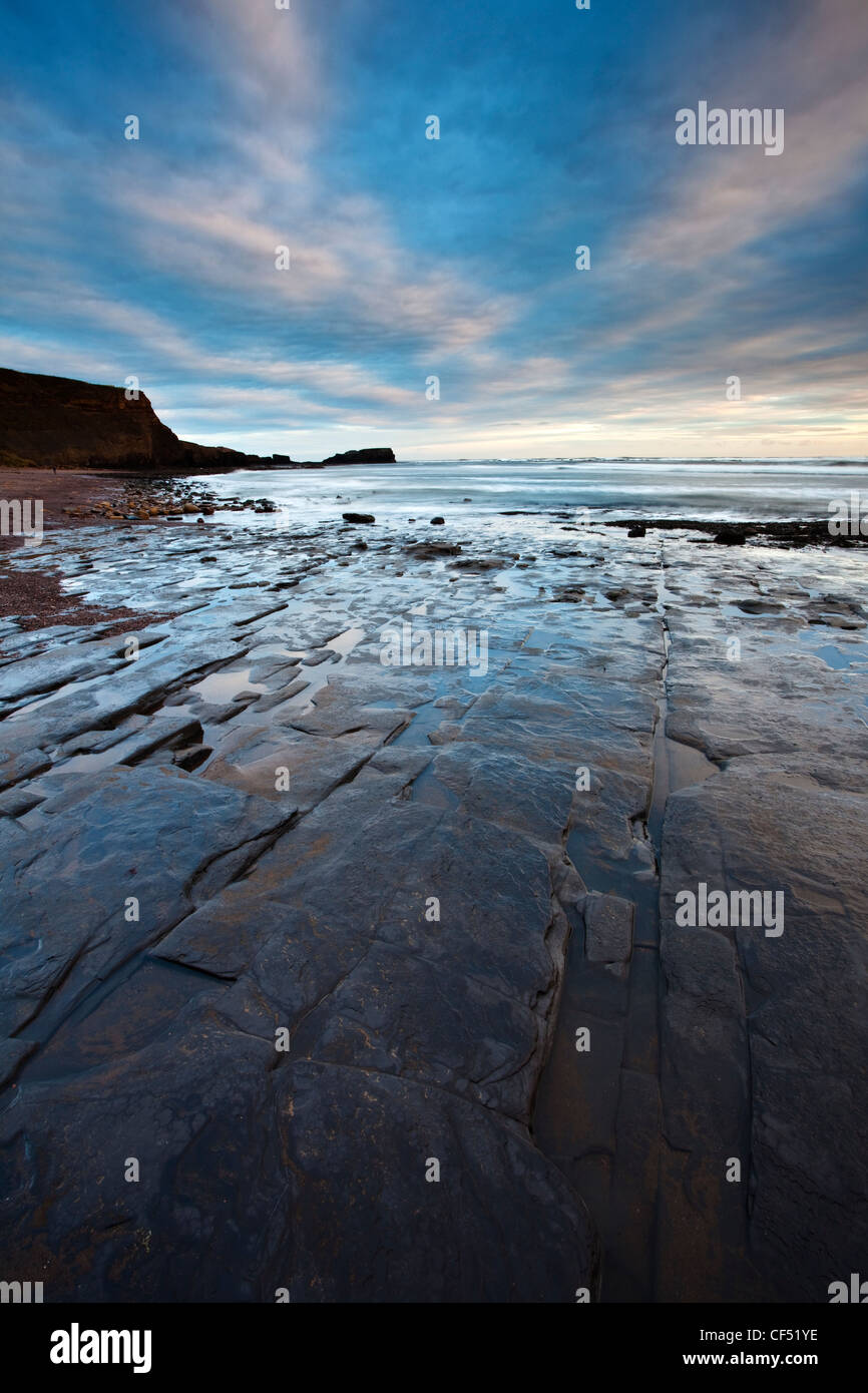 Shale pavement at low tide in Saltwick Bay near Whitby on the North Yorkshire Coast. - Stock Image