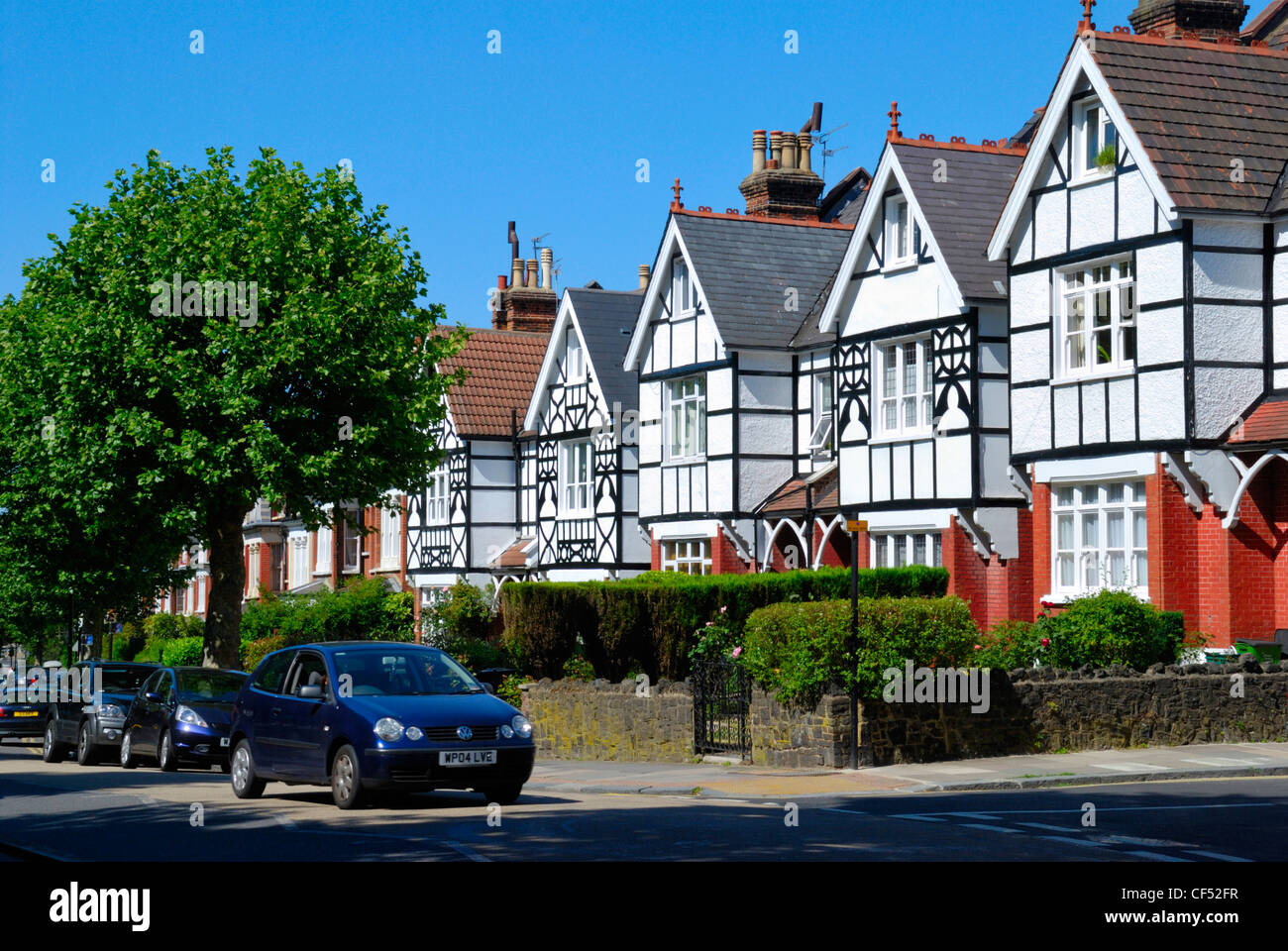 Mock Tudor houses in Muswell Hill Road. - Stock Image