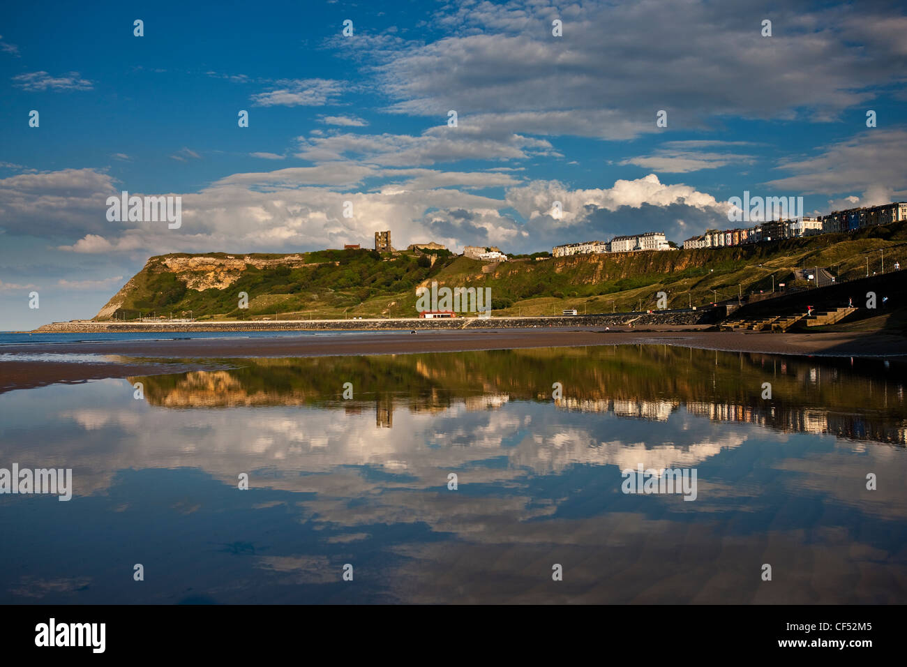 Scarborough Castle on a promontory overlooking North Bay. - Stock Image