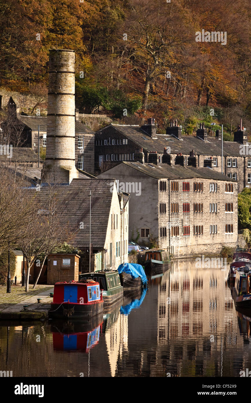 Barges moored on the Rochdale canal at Hebden Bridge in Calderdale. - Stock Image