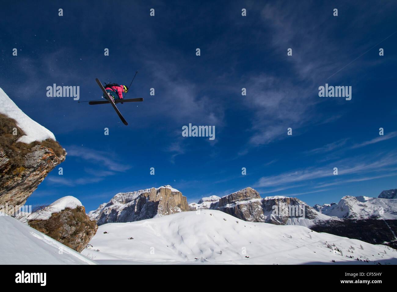 Italy, Sella, Dolomites, Man doing freestyle skiing - Stock Image
