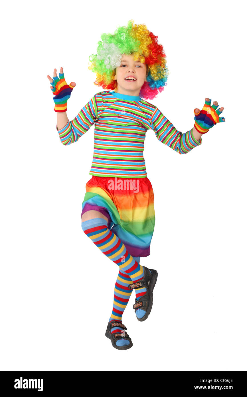 little boy in clown dress standing on one leg isolated on white background Stock Photo