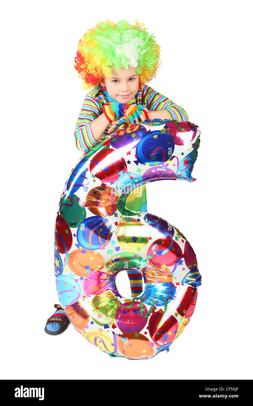 boy in clown dress with balloon shape six isolated on white background Stock Photo