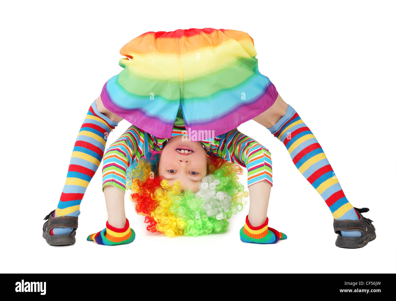 little boy in clown dress somersault isolated on white Stock Photo