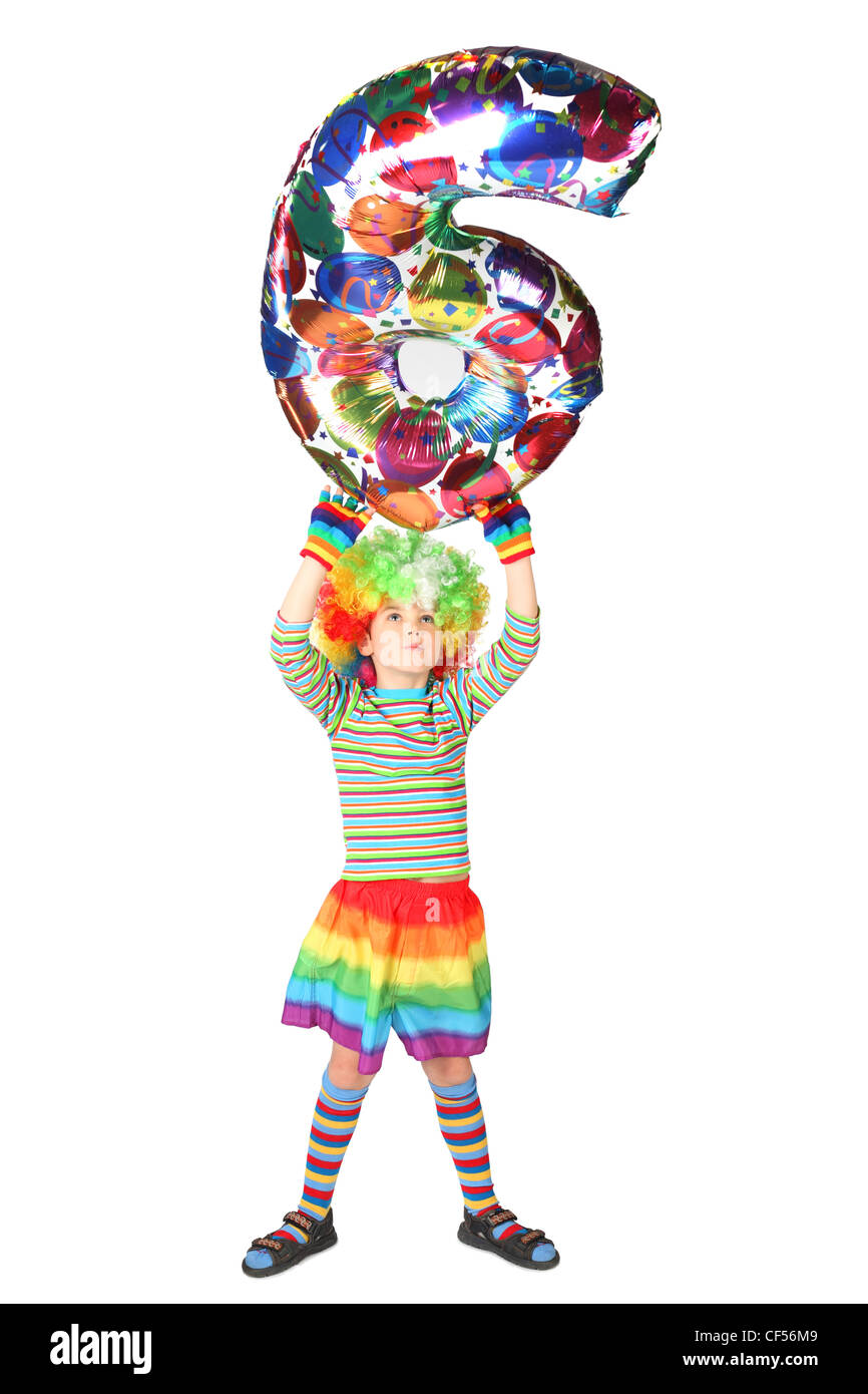 boy in clown dress with balloon shape six over his head isolated on white background Stock Photo