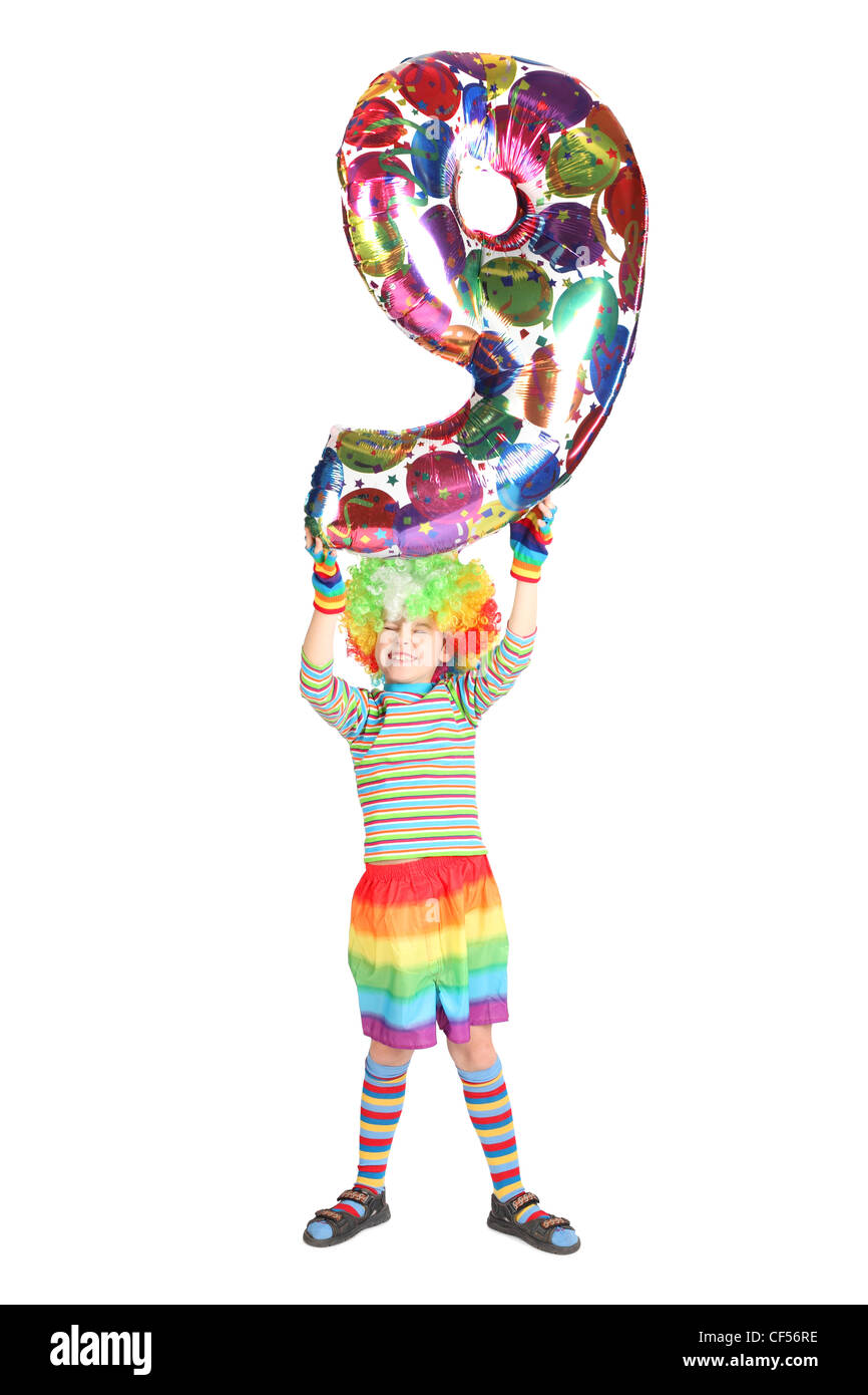 boy in clown dress with balloon shape nine over his head isolated on white background Stock Photo