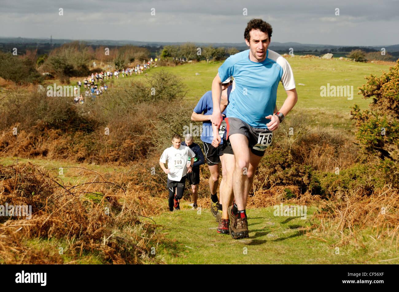 Fell runners in the Moel y Ci Fell Race Snowdonia - Stock Image