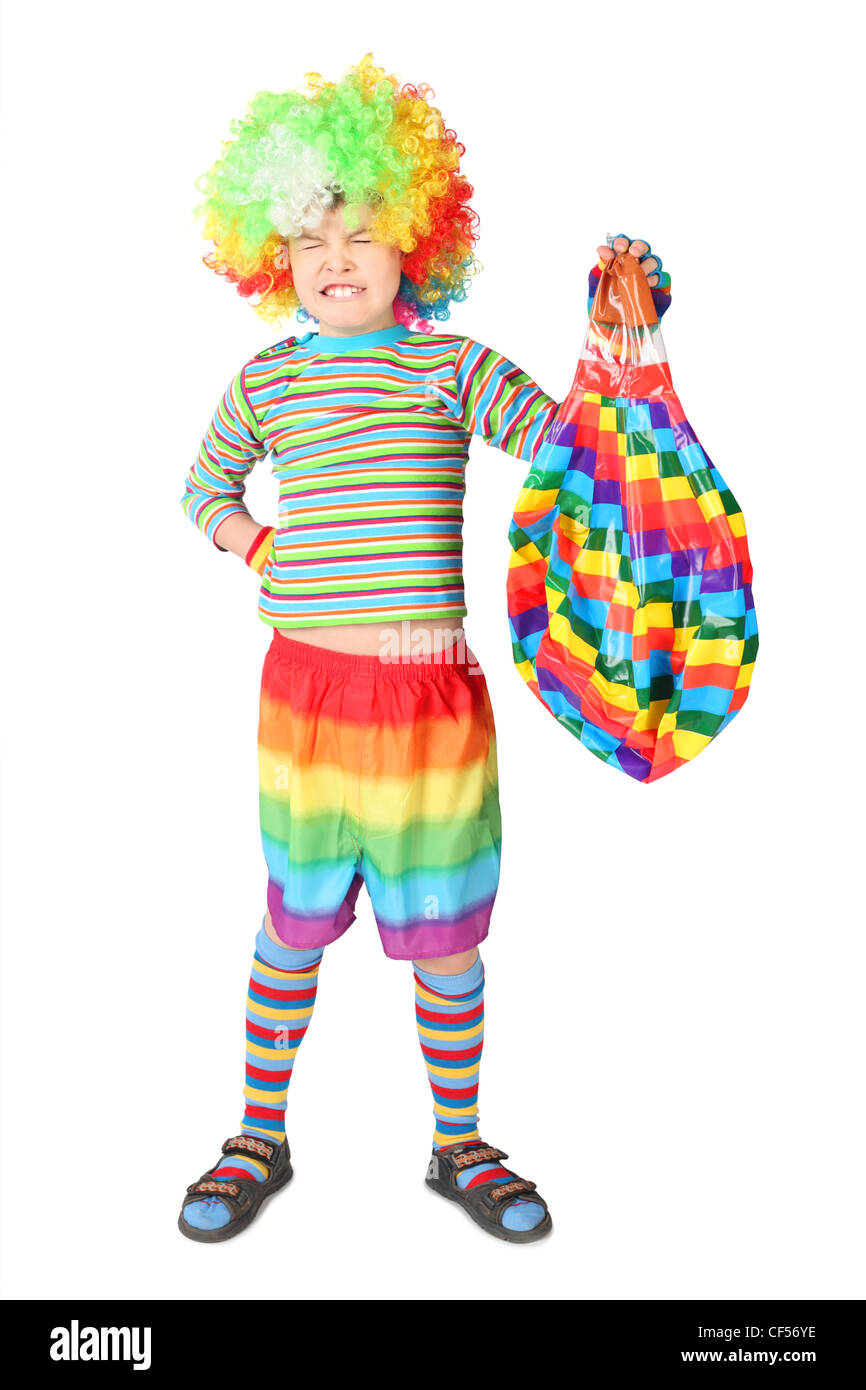 boy in clown dress with multicolored baloon isolated on white background - Stock Image