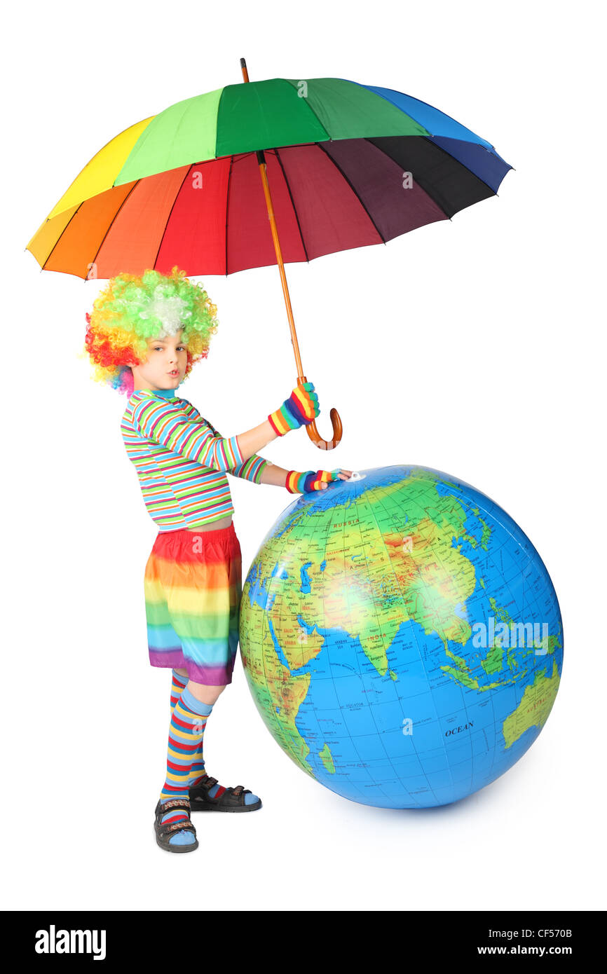 boy in clown dress with umbrella and big globe isolated on white background Stock Photo