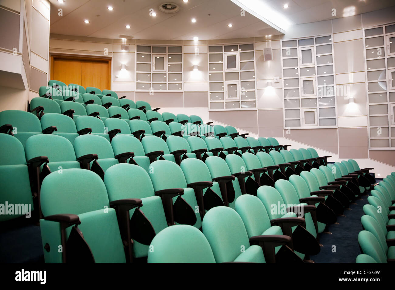 empty conference hall, rows of a chairs, eight numbers in shot Stock Photo