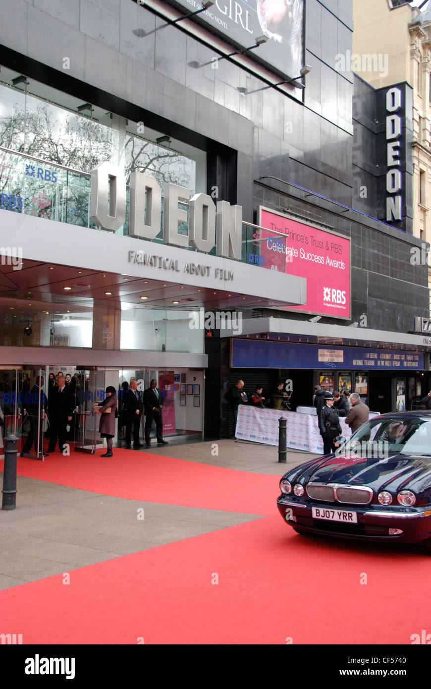 A limousine and red carpet outside the Odeon Leicester Square cinema. - Stock Image