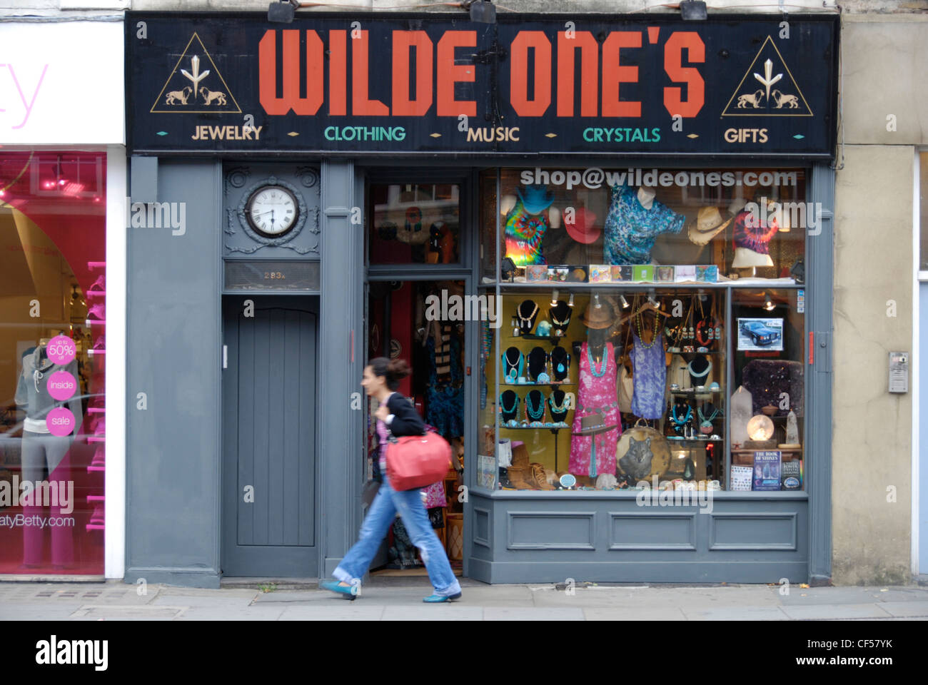 A young woman passing Wilde Ones alternative fashion shop on Kings Road. - Stock Image