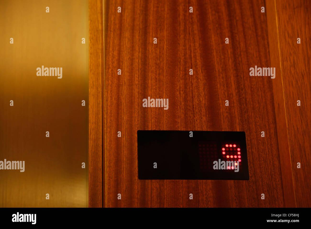 Germany, Berlin, Number 9 displaying in elevator - Stock Image