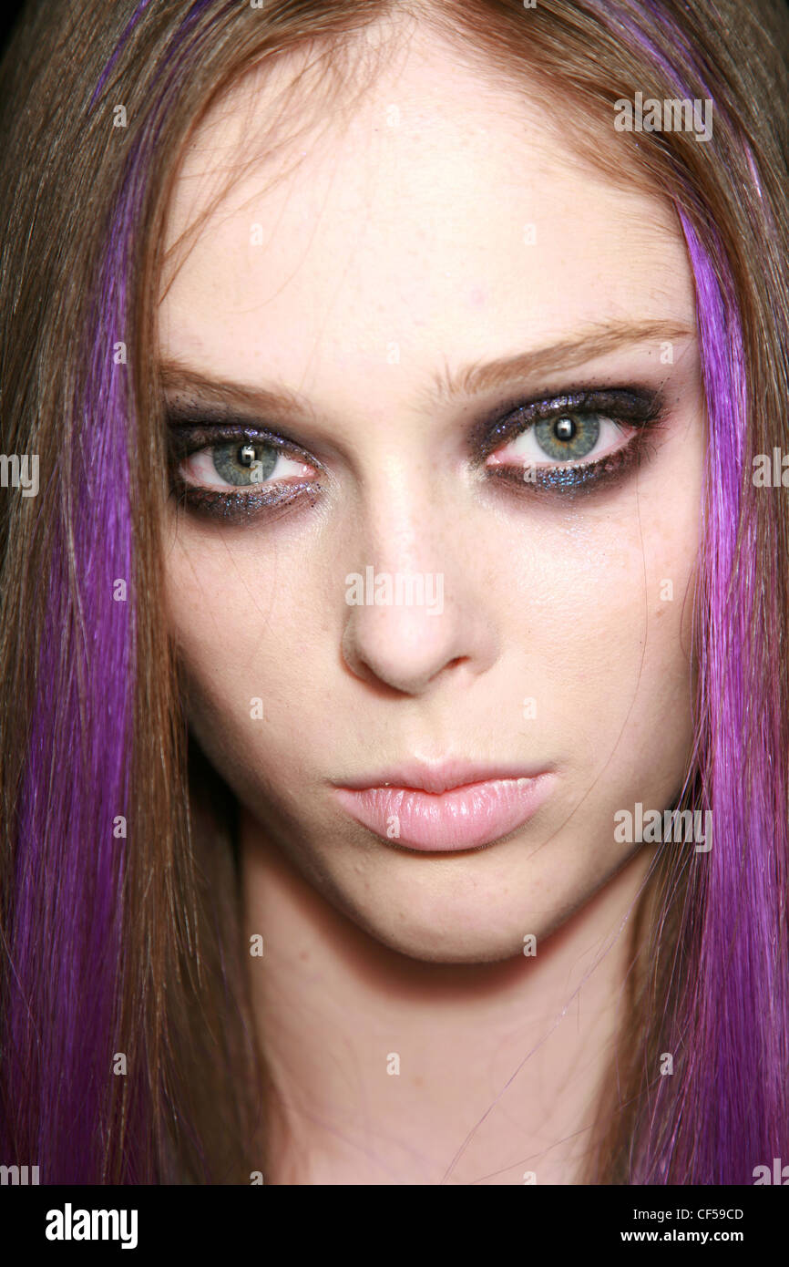 Anna Sui Backstage New York Ready to Wear Spring Summer Gothic Make Up: Close up face, brunette female purple hairstrip, - Stock Image