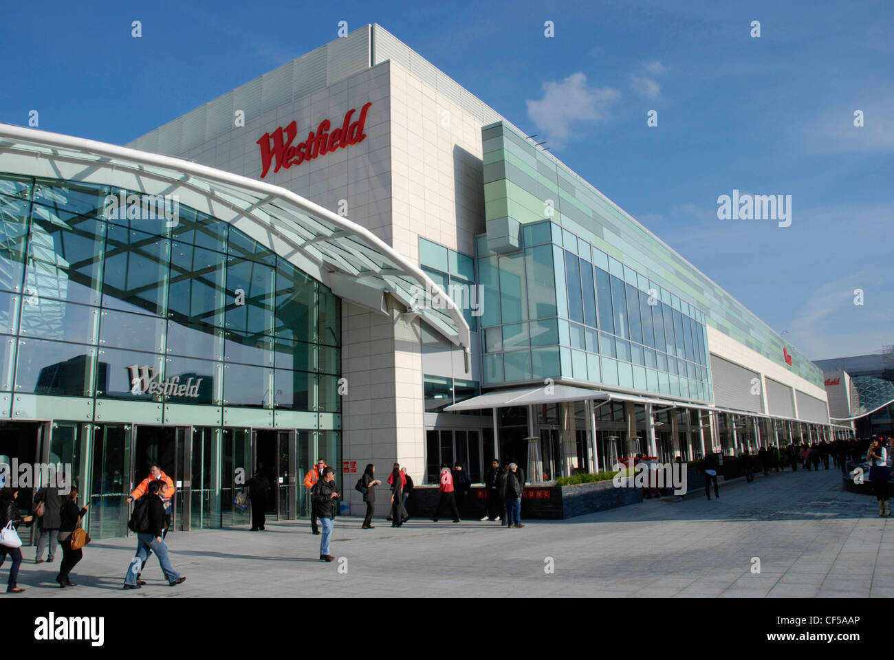 Visitors outside the Westfield Shopping Centre in Shepherds Bush. - Stock Image