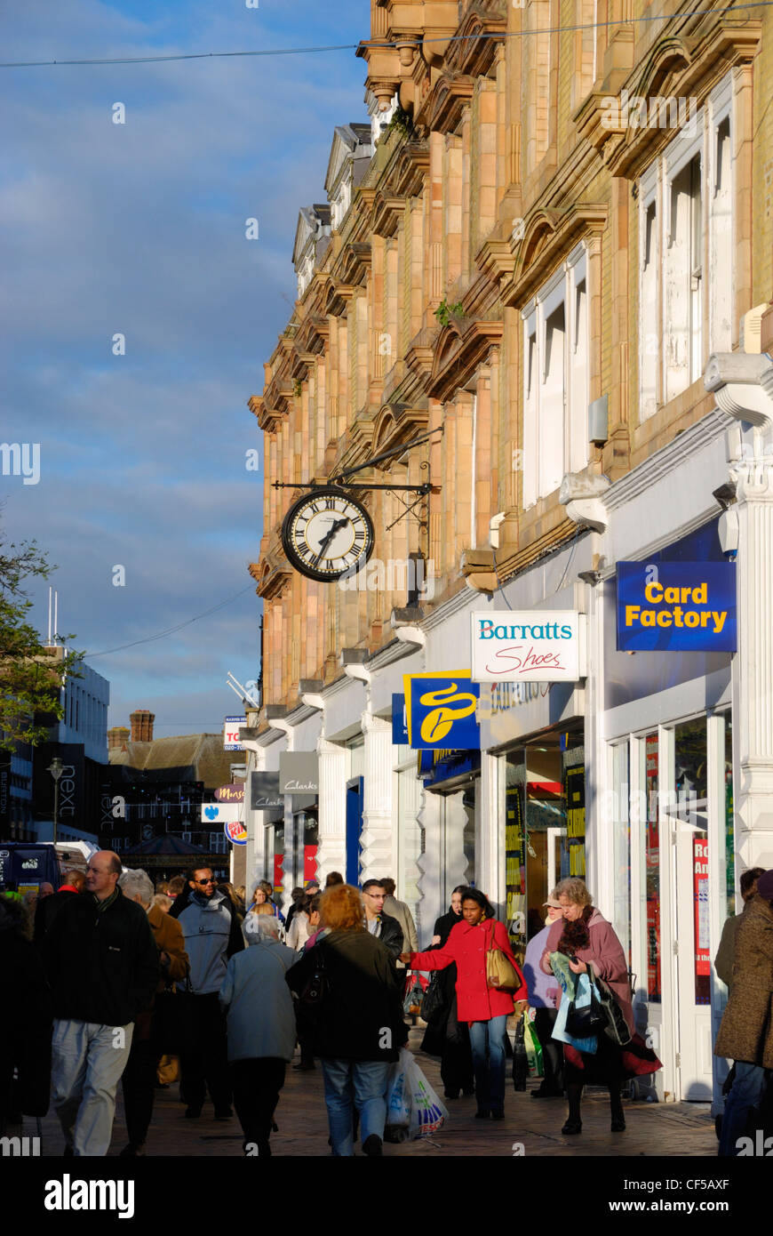 Shoppers outside shop fronts in  Bromley High Street. - Stock Image