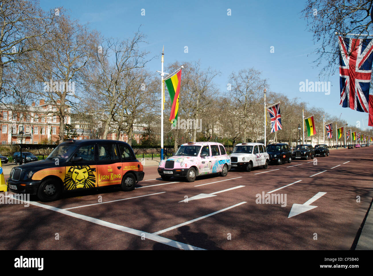 Taxi cabs at the Mall lined with Union Jack and European Union flags. - Stock Image