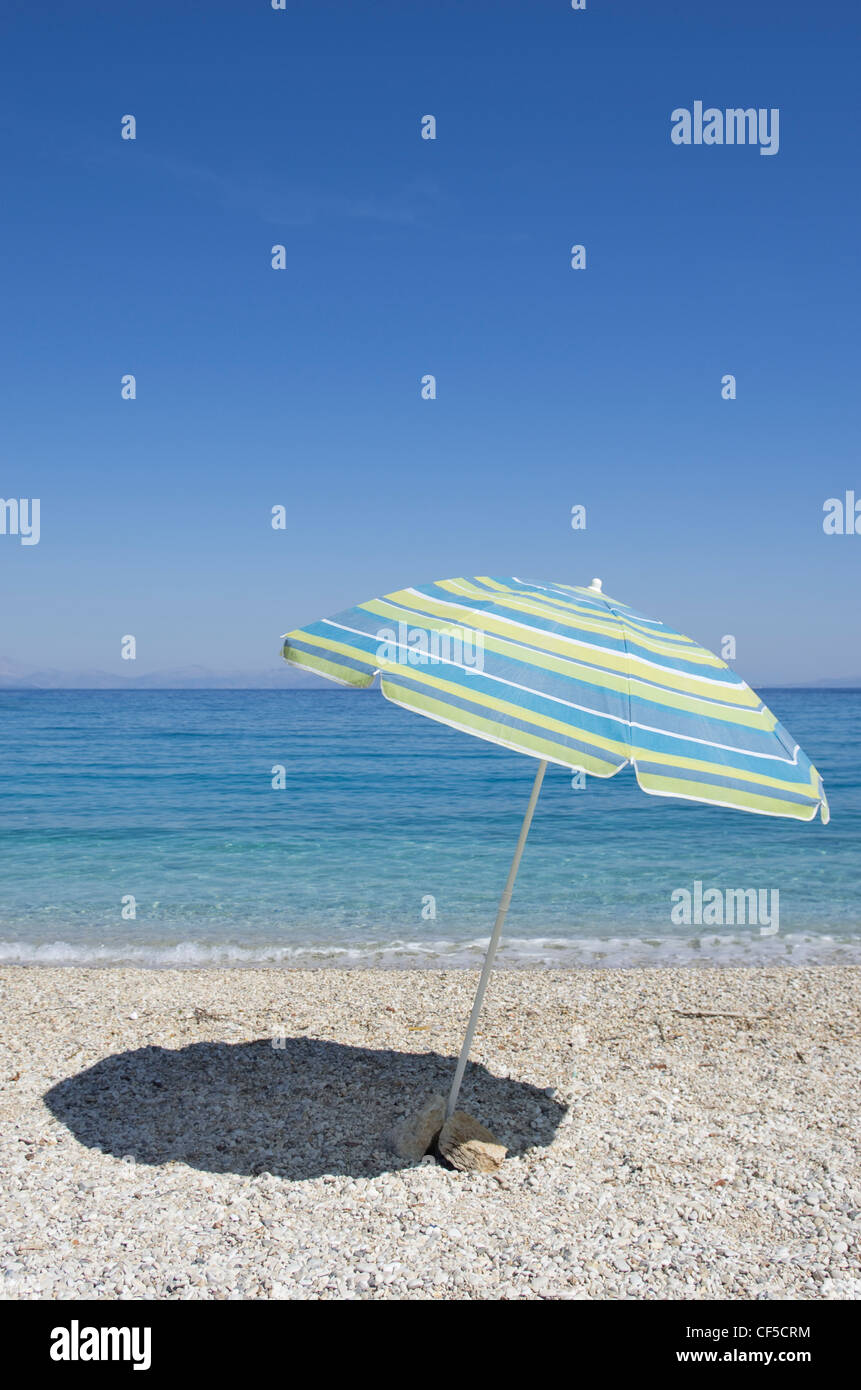 Greece, Ionian Islands, Ithaca, View of beach with sunshade - Stock Image