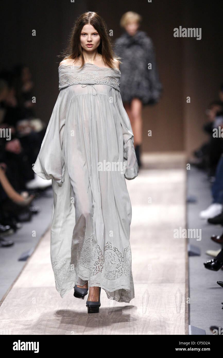 6f1f7bc825da7 Stella McCartney Paris Ready to Wear Autumn Winter Model wearing a light  grey flolength off the