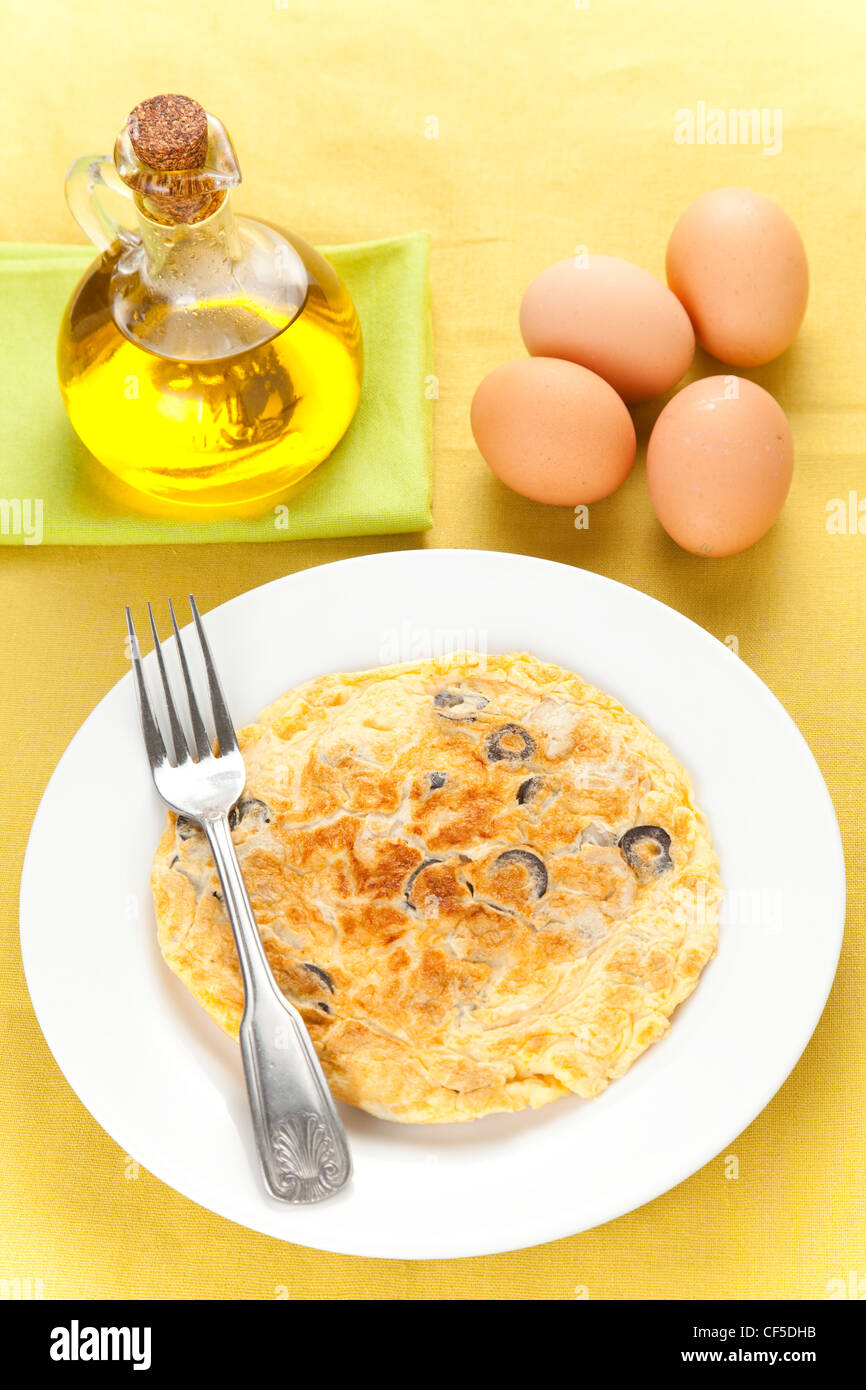 mushrooms olives and potatoes omelette - Stock Image