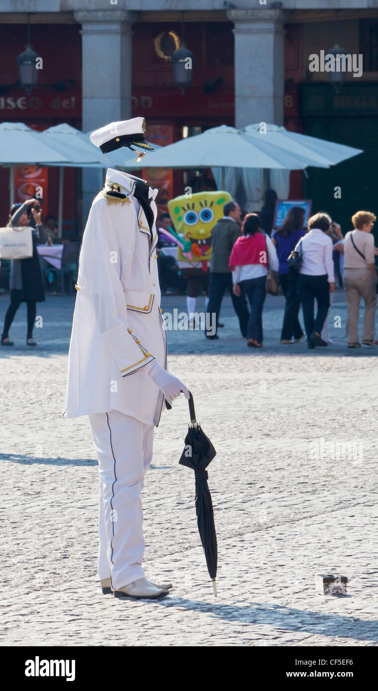 Madrid, Spain. Busker in Plaza Mayor dressed as the Invisible Man. - Stock Image