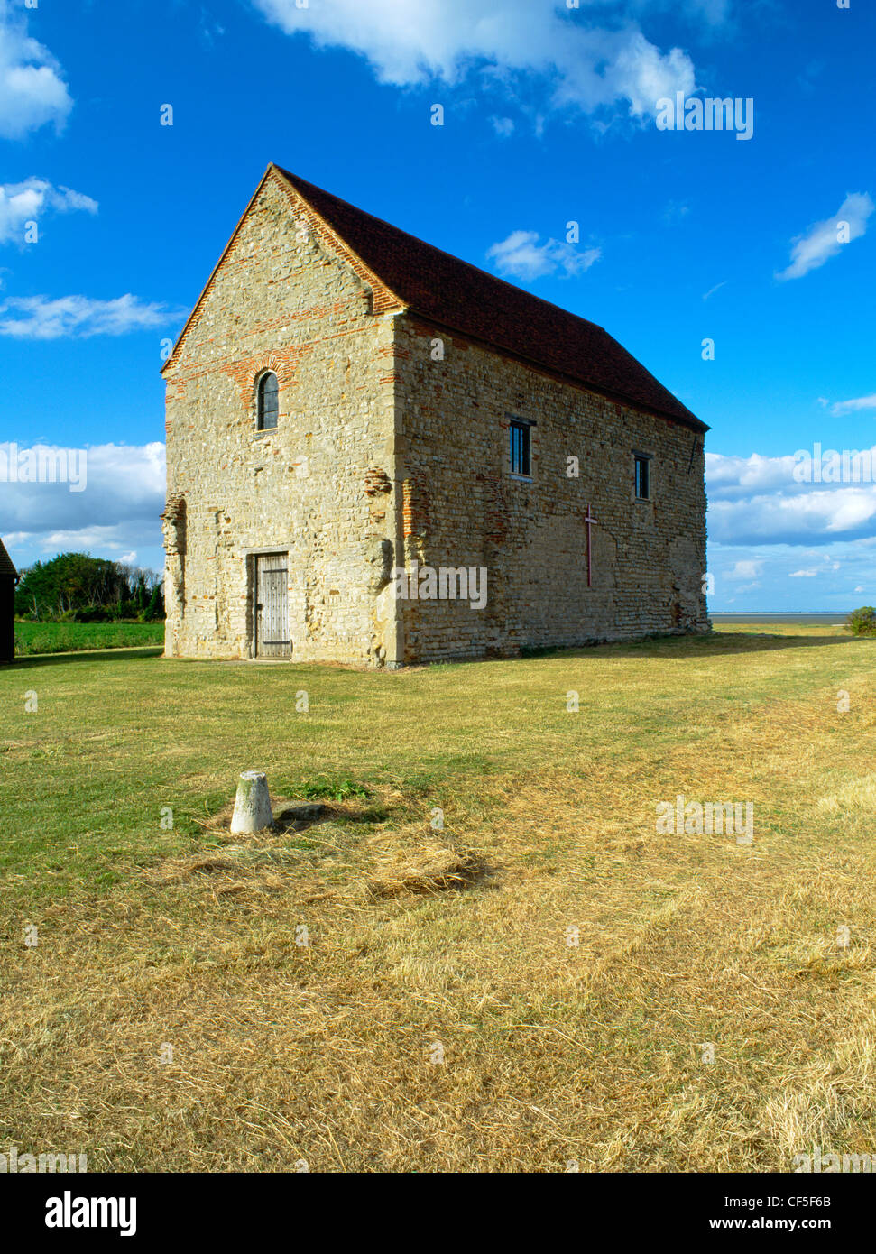 The nave of St Peter's 7th-century chapel, built of reused Roman materials on the site of Othona Roman fort. - Stock Image