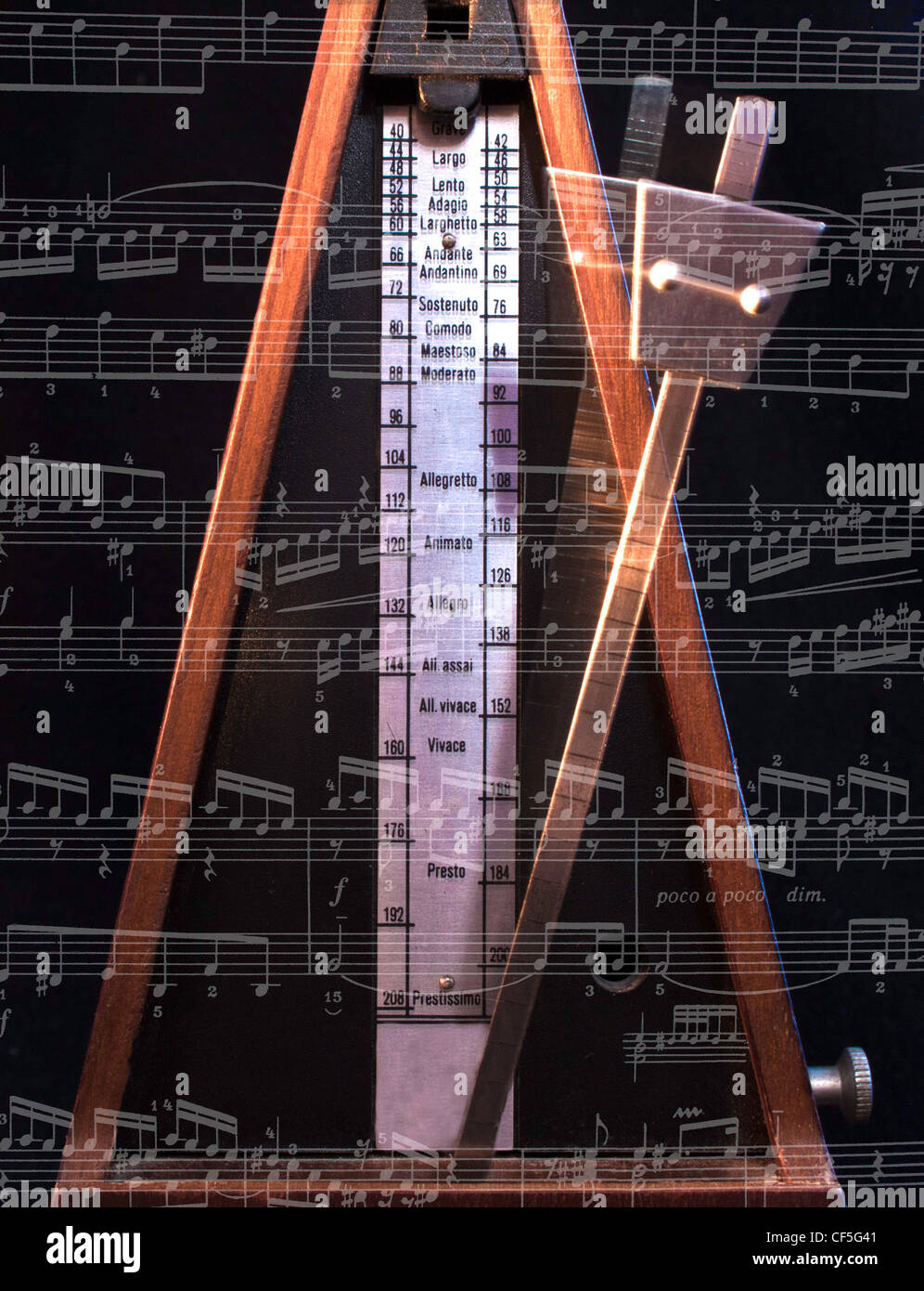 Old metronome with blur motion on the black - Stock Image