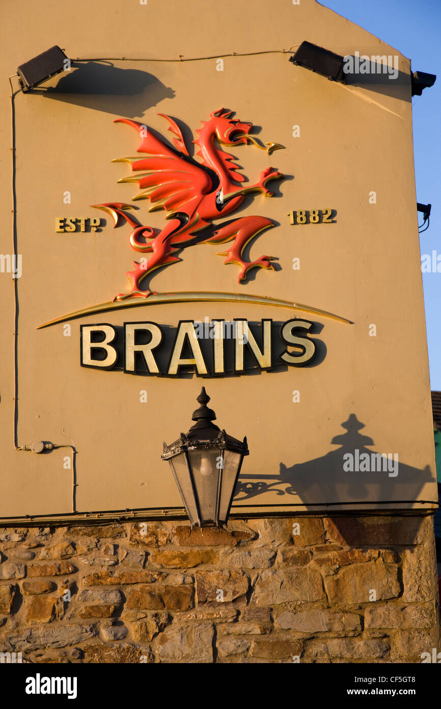 Logo of Brains Brewery, the red Welsh dragon, on the wall of a pub in Pembrokeshire, Wales - Stock Image