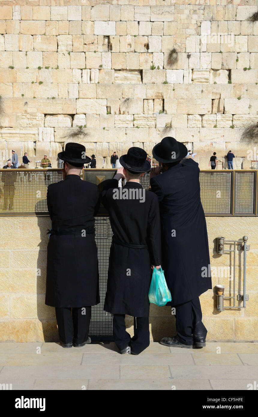Crowds worship at the Western Wall, the holiest site in Judaism outside the Temple Mount itself in Jerusalem, Israel. Stock Photo