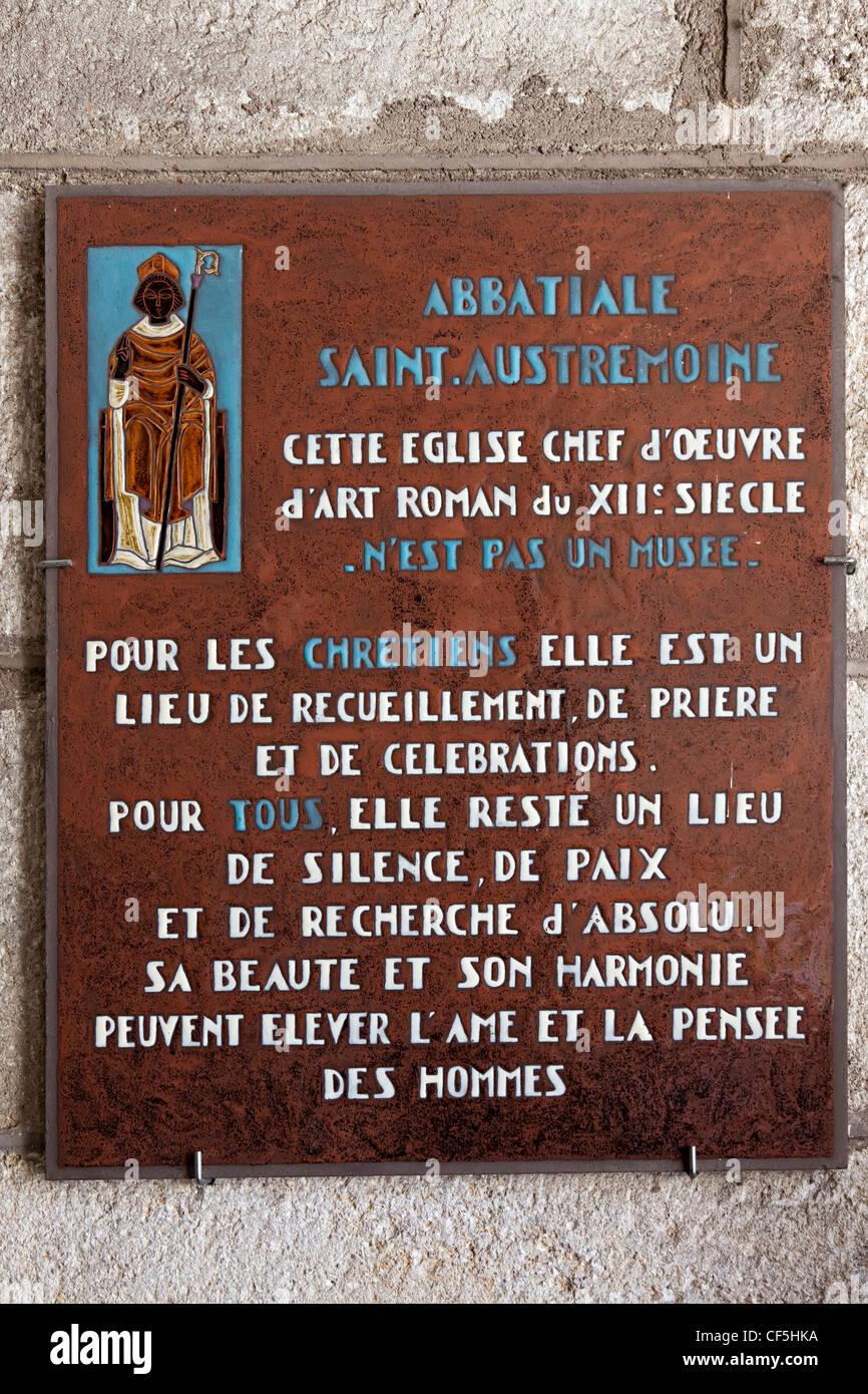 Plaque on the Abbatiale Romane Saint-Austremoine decorated church, Issoire, Puy-de-Dome, Auvergne, France - Stock Image