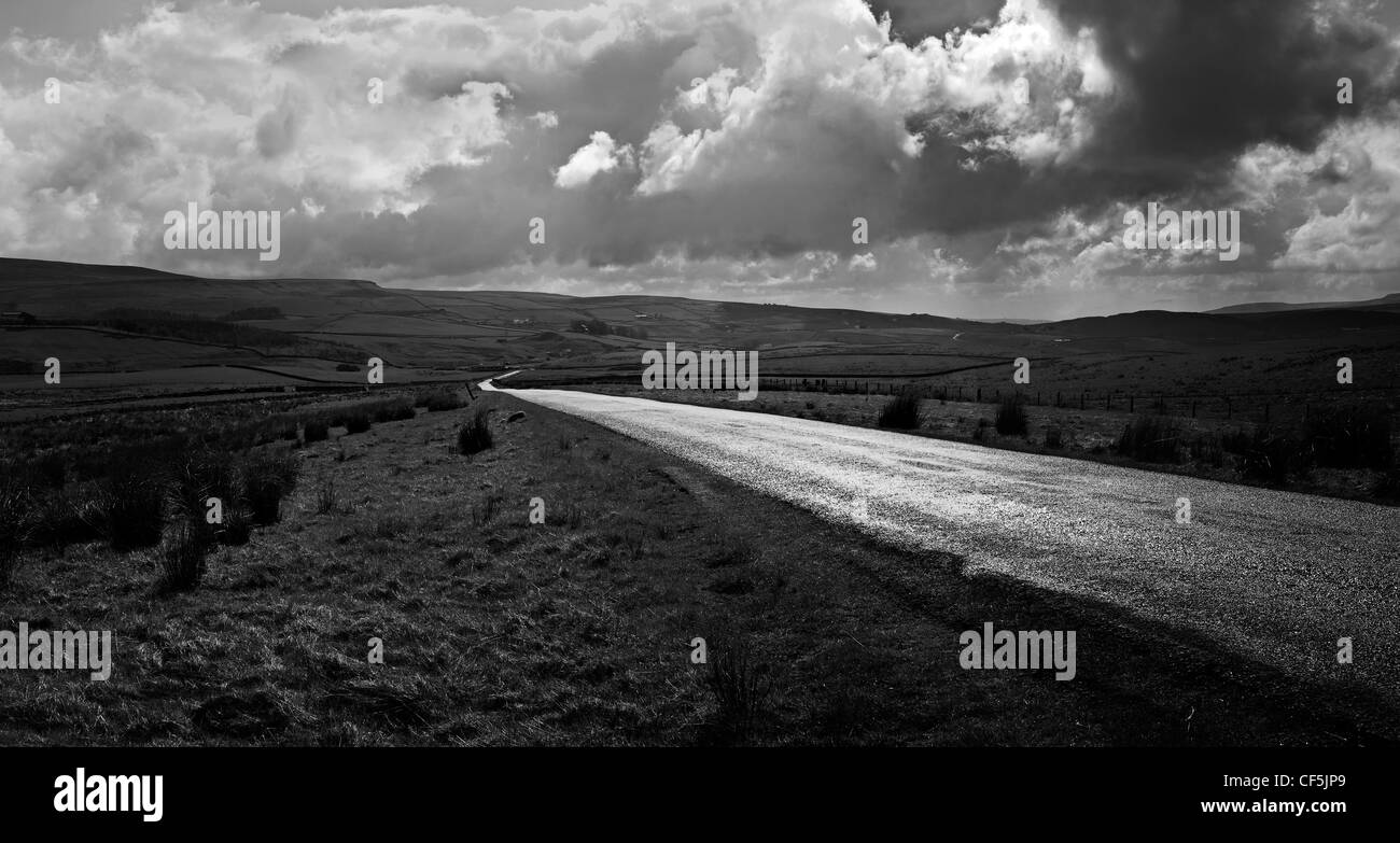 Black and white of the Durham Dales with single track road winding its way through Teesdale and Weardale Stock Photo