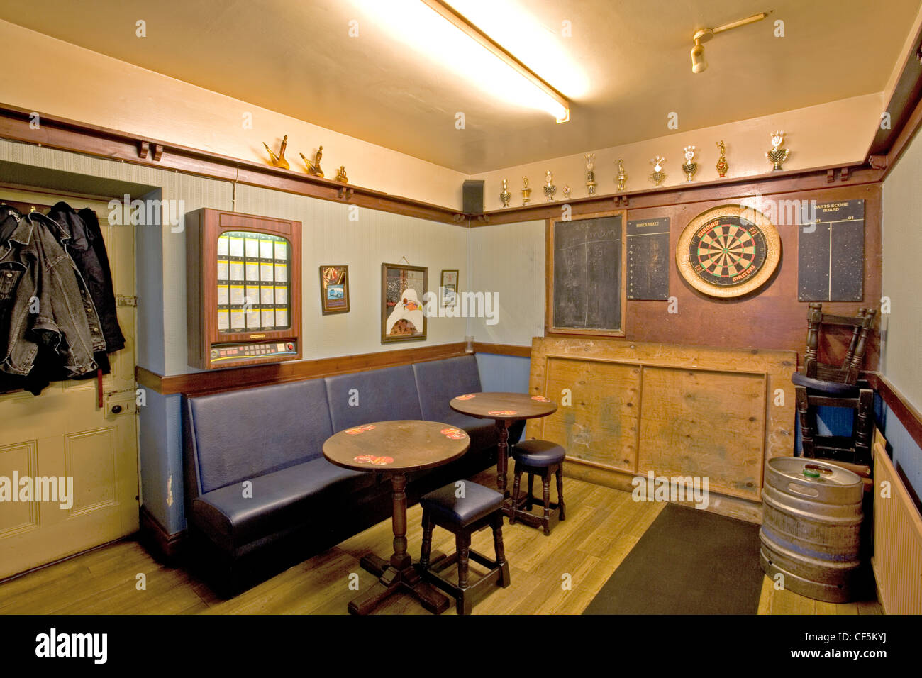 A pub games room in The Admirals Head. Before thermometers were invented, brewers would dip a thumb or finger into - Stock Image