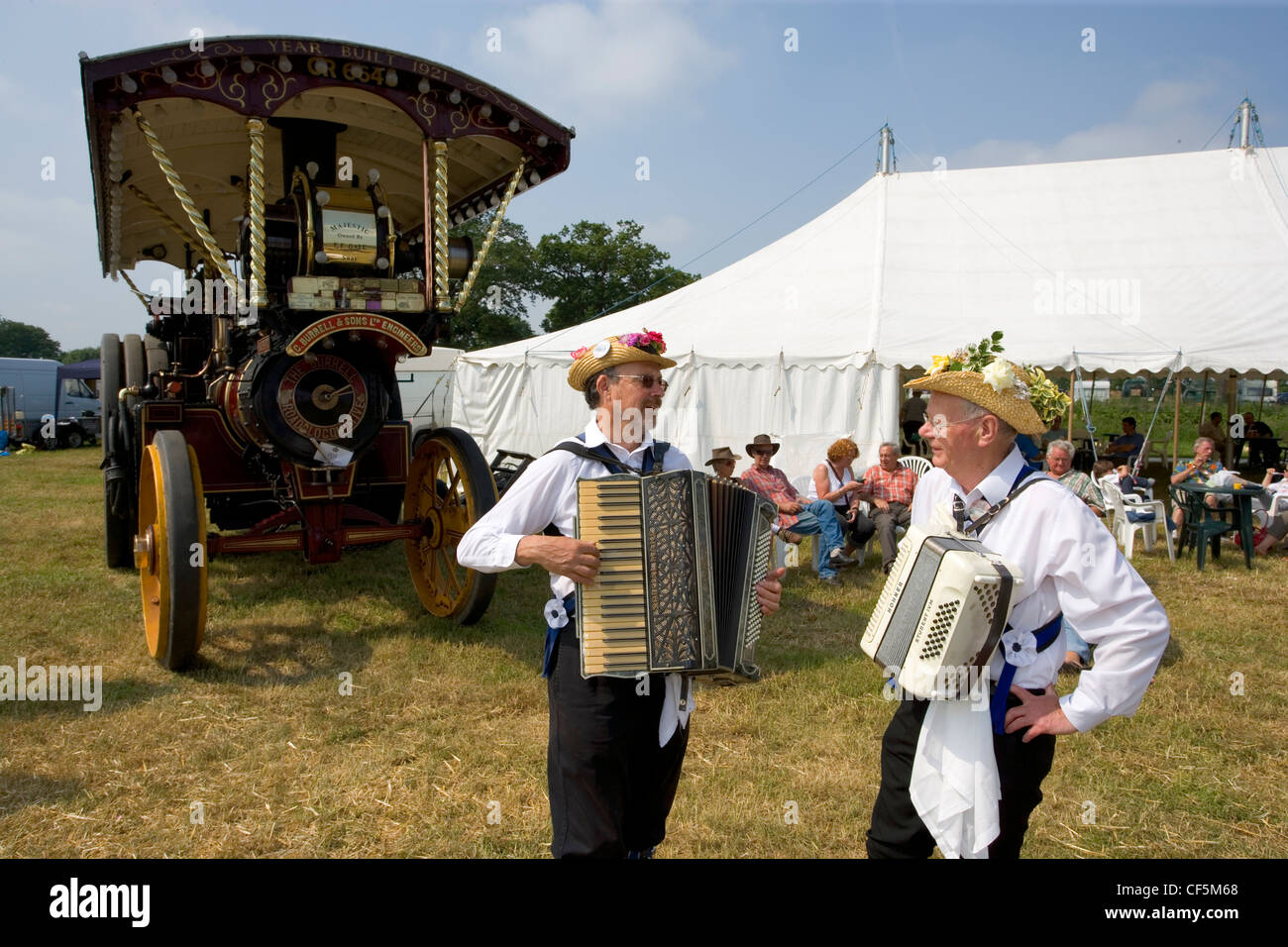 The Offley Morris Men and a Burrell Showman's Locomotive at the Whitwell Steam and Country Fair. The ritual - Stock Image