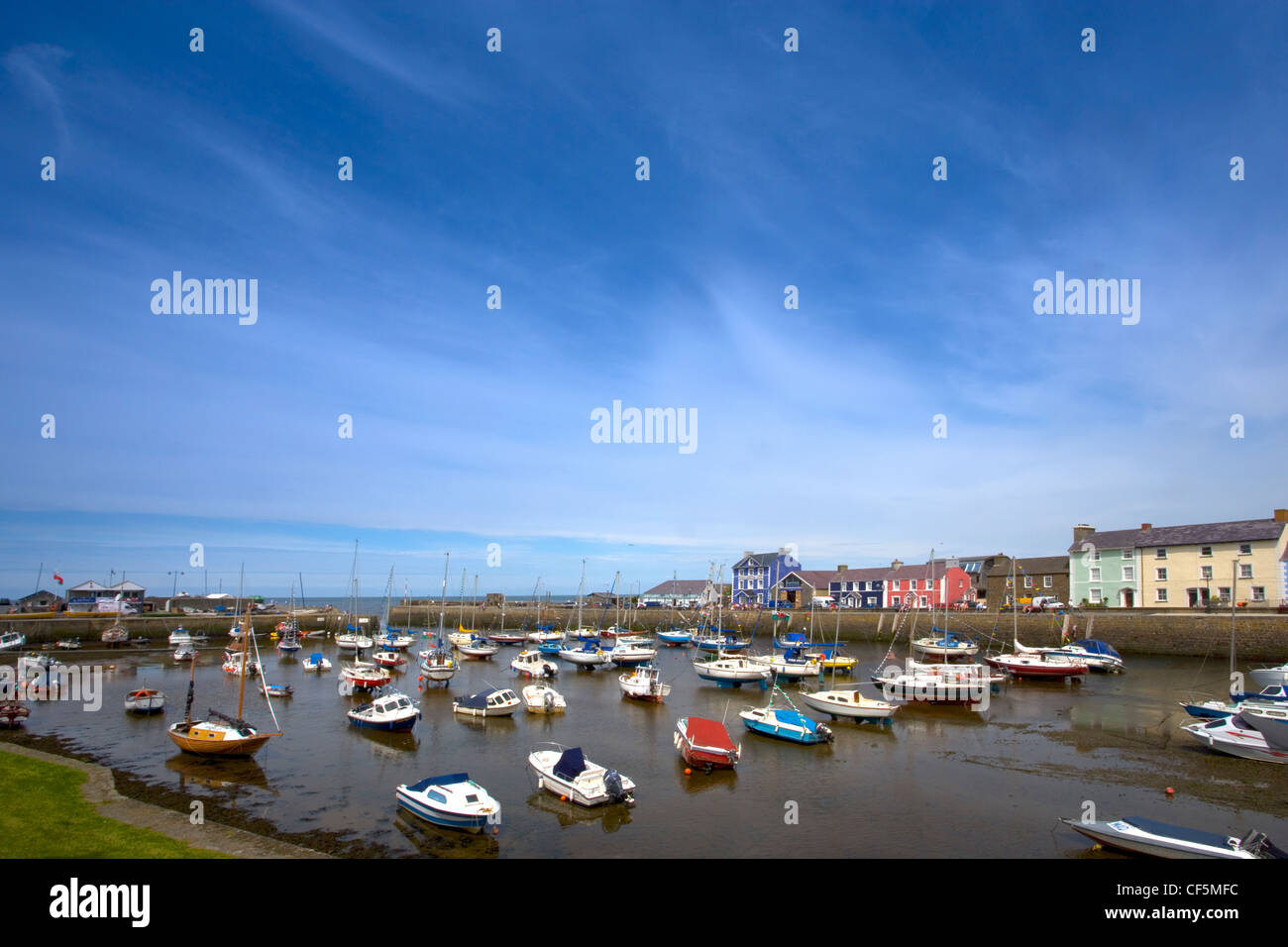 Small boats in the harbour at Aberaeron. It is one of Wales' very first planned towns, the idea of establishing - Stock Image