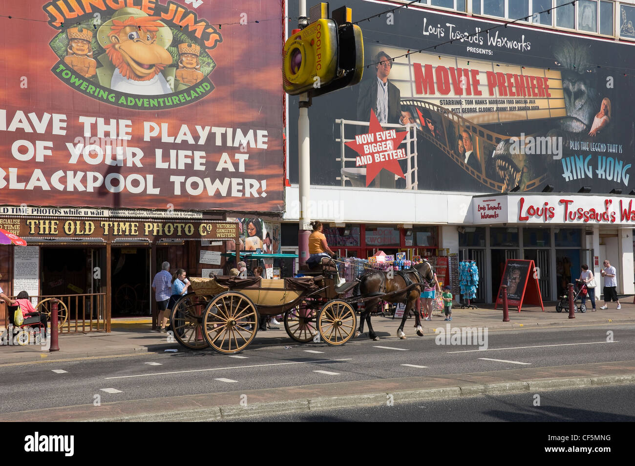 Horse and carriage outside Louis Tussaud's Waxworks on the Golden Mile in Blackpool. Stock Photo