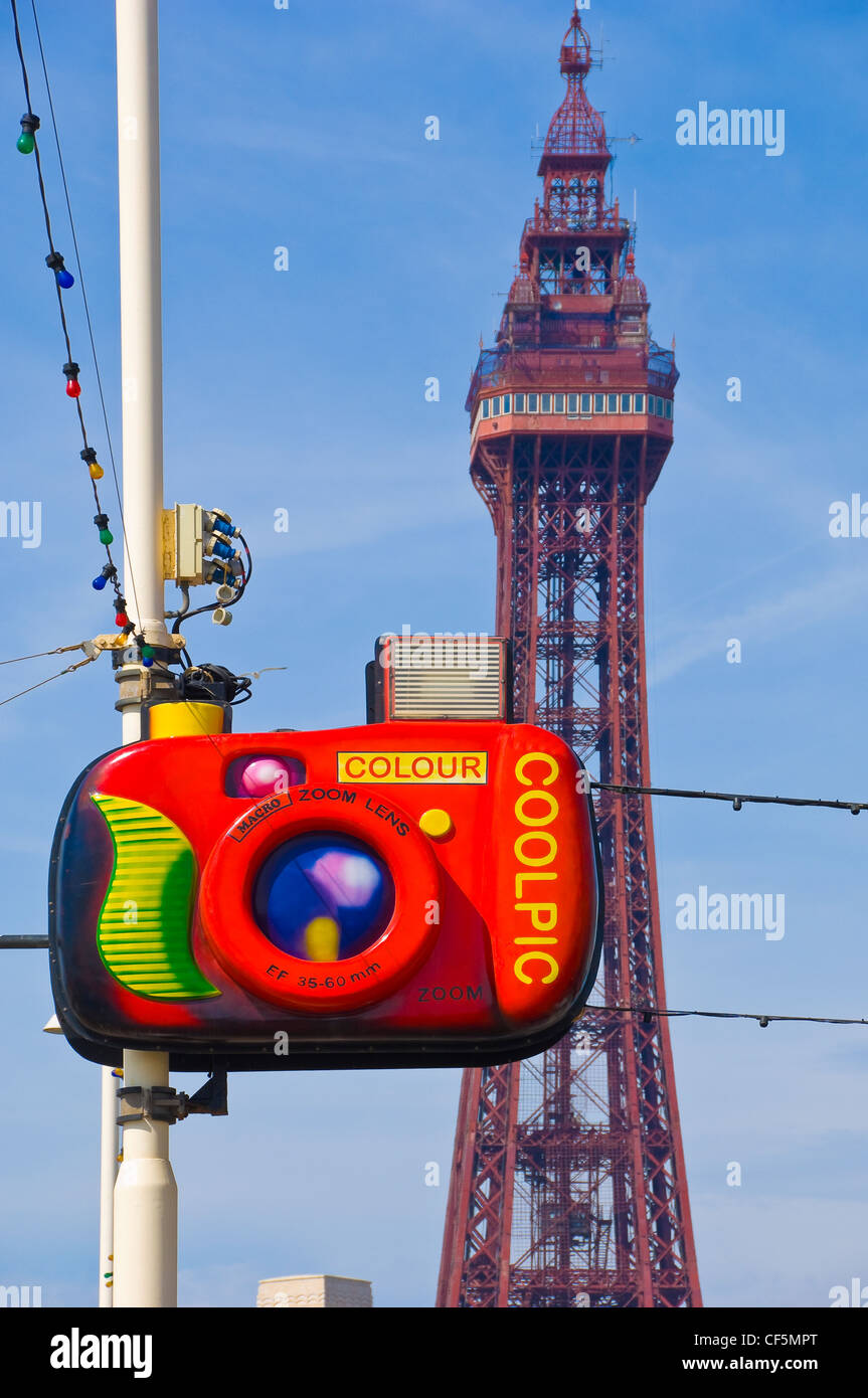 Street illuminations and Blackpool tower along the Golden Mile. - Stock Image