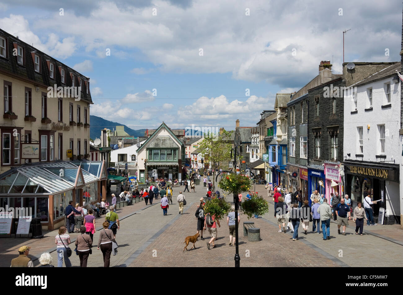 Walkers and shoppers in Market Place, Keswick, which is now renovated into a pedestrian priority area. - Stock Image