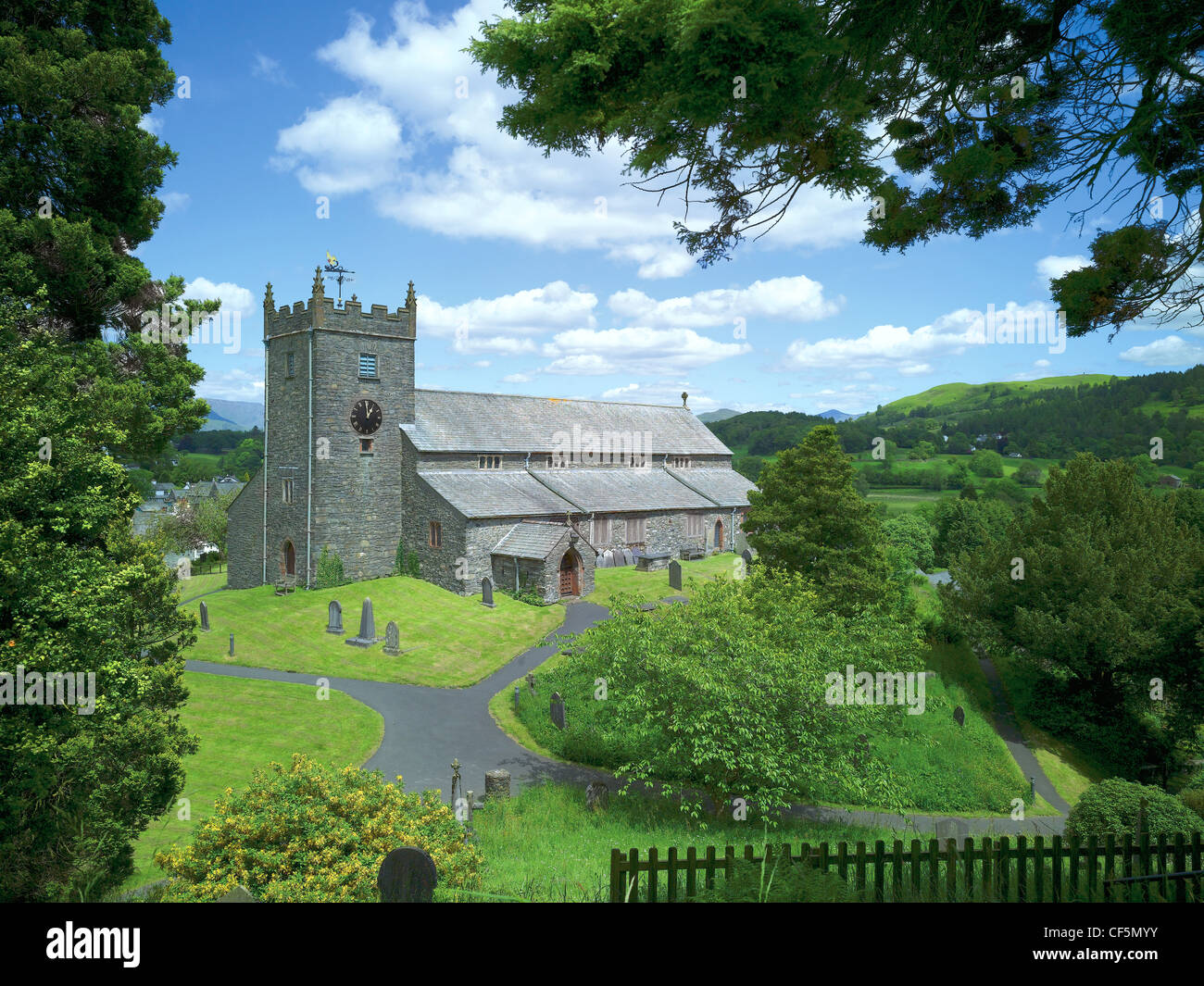 The 15th century parish church of St Michael and All Angels in Hawkshead. William Wordsworth, who went to school - Stock Image