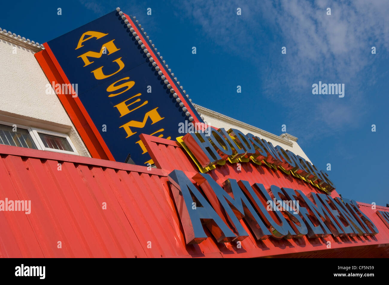 Holdsworths Amusements signs on the seafront at Filey. - Stock Image
